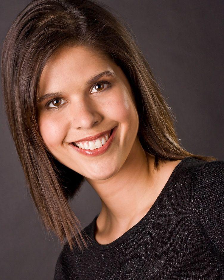 07-Headshot-of-smiling-female-writer-on-dark-background-(Alison-Overholt)